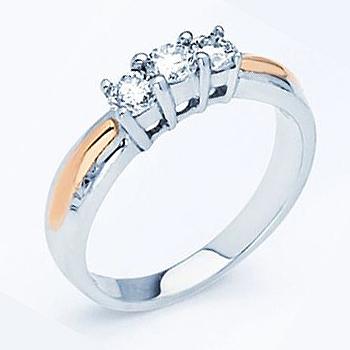 14kt Two Tone Diamond Anniversary Ring.  Three Round Brilliant Diamonds