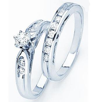 14kt Diamond Bridal Set; 1/4ct Round Brilliant Center Diamond; with .40cttw S...