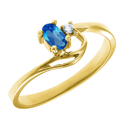 Genuine Blue Topaz 5x3 oval (December birthstone) set in 10kt yellow gold rin...