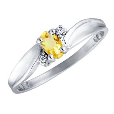 Genuine Citrine 5x3 oval (November birthstone) set in 10kt white gold ring wi...