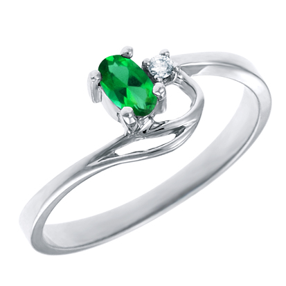 Created Emerald 5x3 oval ( May birthstone) set in 10kt white gold ring with .02ct round diamond a...