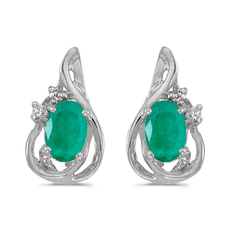 These 14k white gold oval emerald and diamond teardrop earrings feature 6x4 mm genuine natural em...