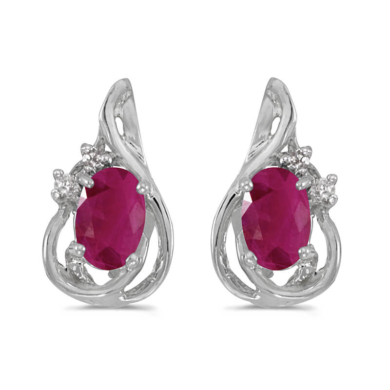 These 14k white gold oval ruby and diamond teardrop earrings feature 6x4 mm genuine natural rubys...