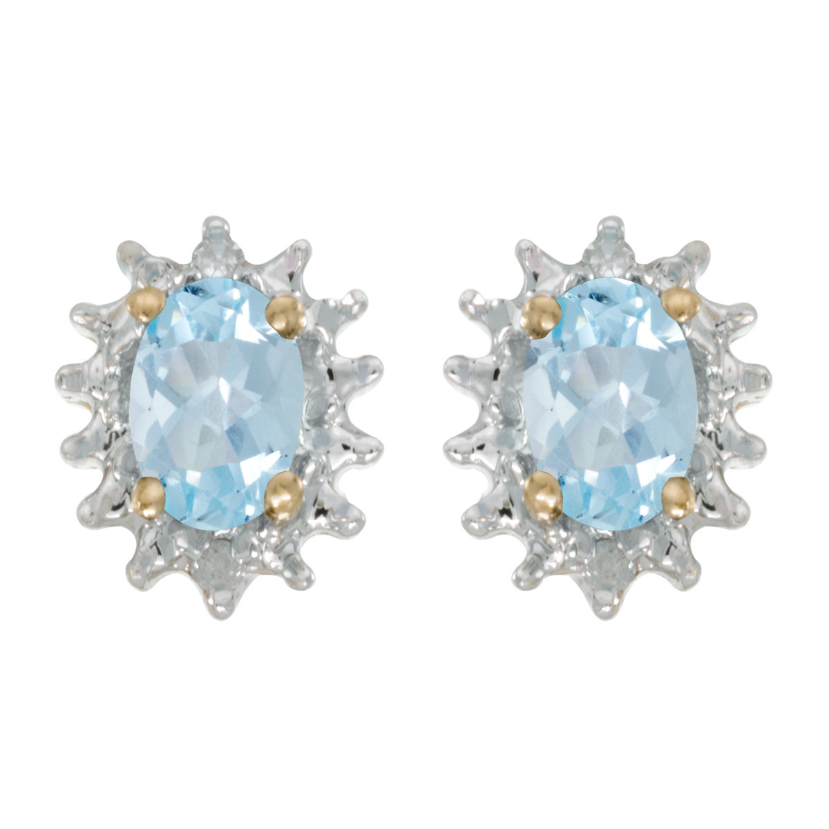 These 14k yellow gold oval aquamarine and diamond earrings feature 6x4 mm genuine natural aquamar...