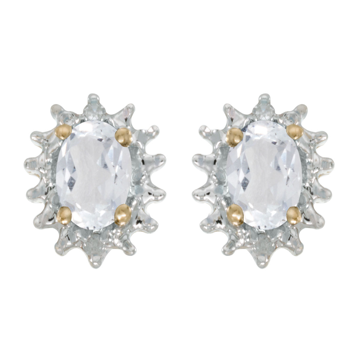 These 14k yellow gold oval white topaz and diamond earrings feature 6x4 mm genuine natural white ...