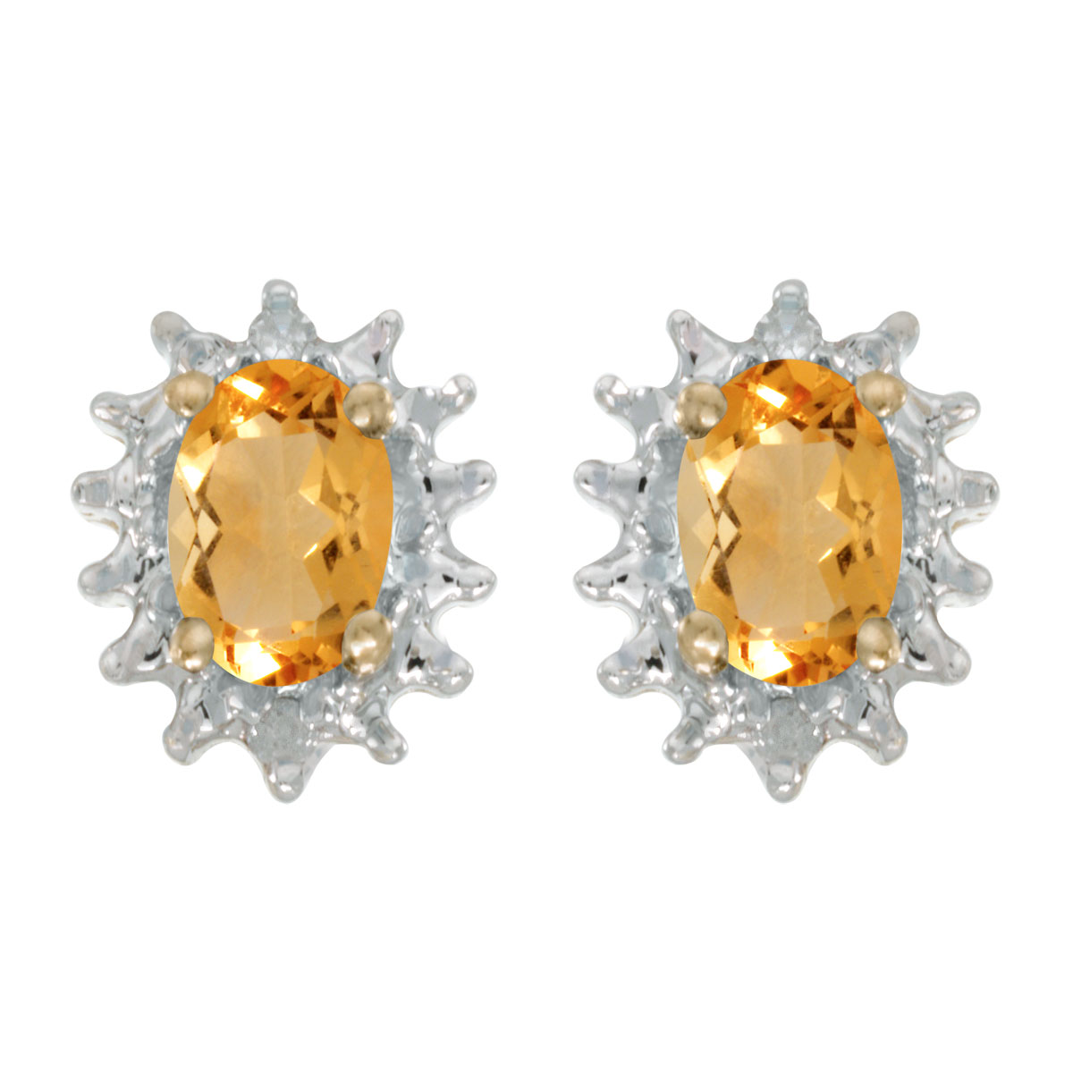 These 14k yellow gold oval citrine and diamond earrings feature 6x4 mm genuine natural citrines w...