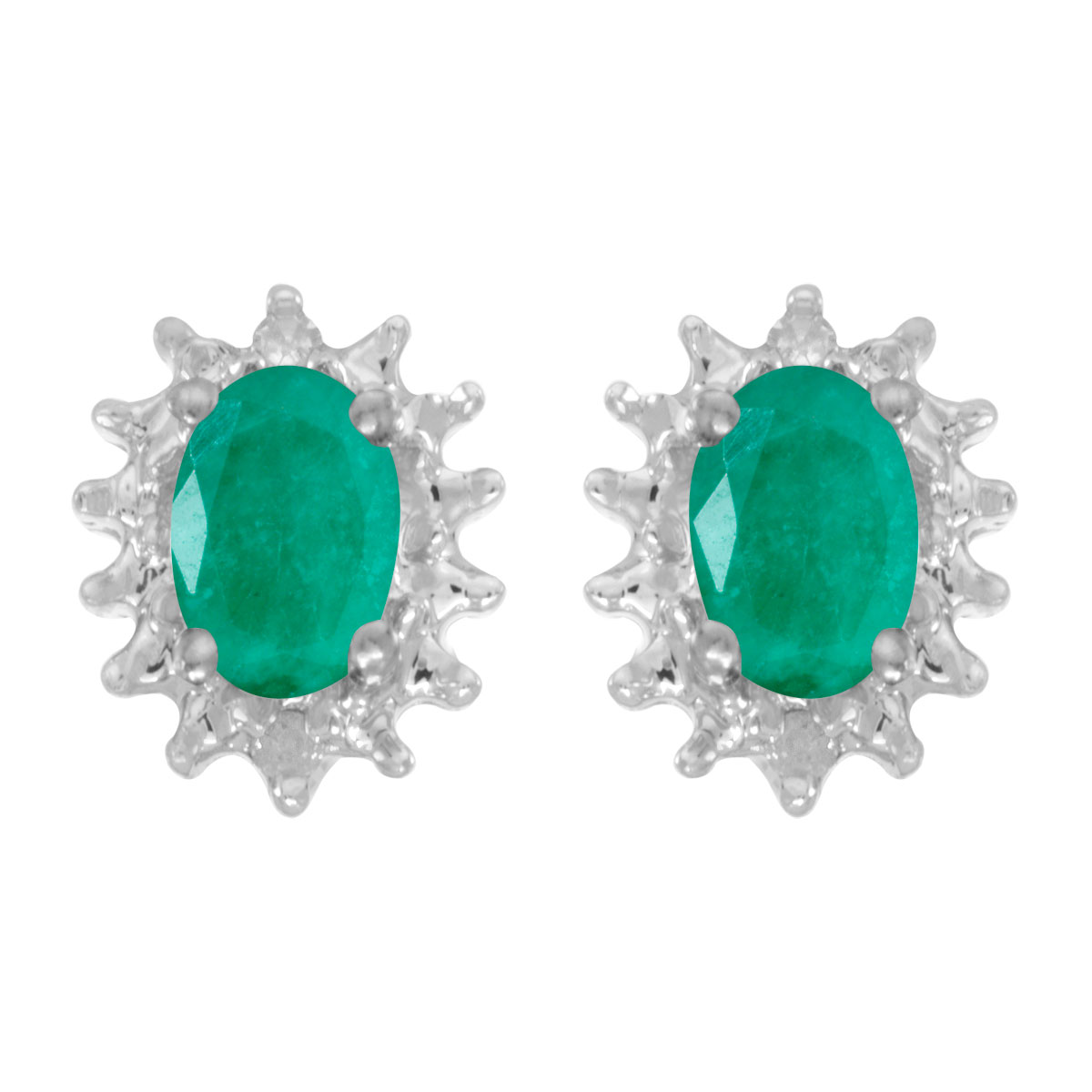 These 14k white gold oval emerald and diamond earrings feature 6x4 mm genuine natural emeralds wi...