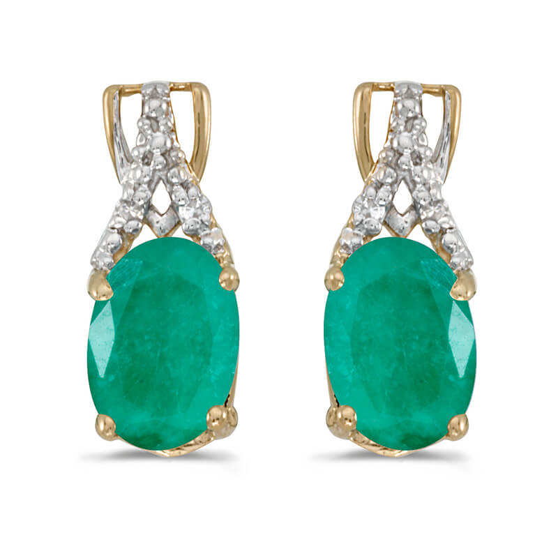 These 14k yellow gold oval emerald and diamond earrings feature 7x5 mm genuine natural emeralds w...