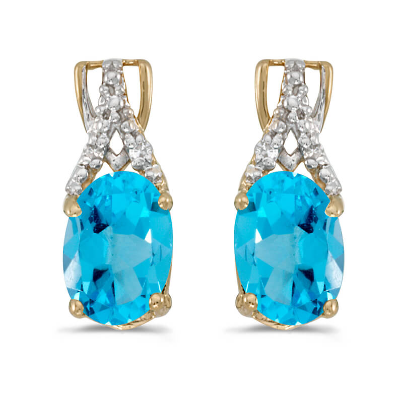 These 14k yellow gold oval blue topaz and diamond earrings feature 7x5 mm genuine natural blue topazs with a 1.32 ct total weight and sparkling diamond accents.