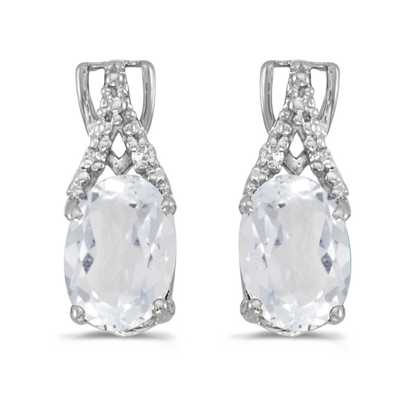 These 14k white gold oval white topaz and diamond earrings feature 7x5 mm genuine natural white t...
