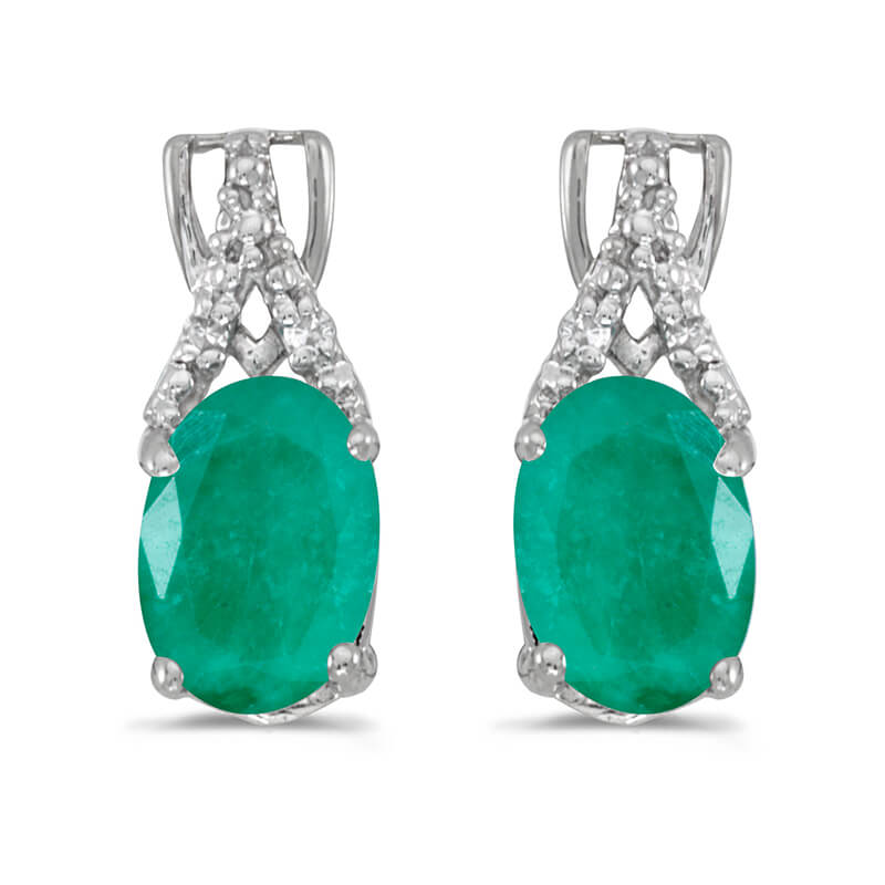 These 14k white gold oval emerald and diamond earrings feature 7x5 mm genuine natural emeralds wi...