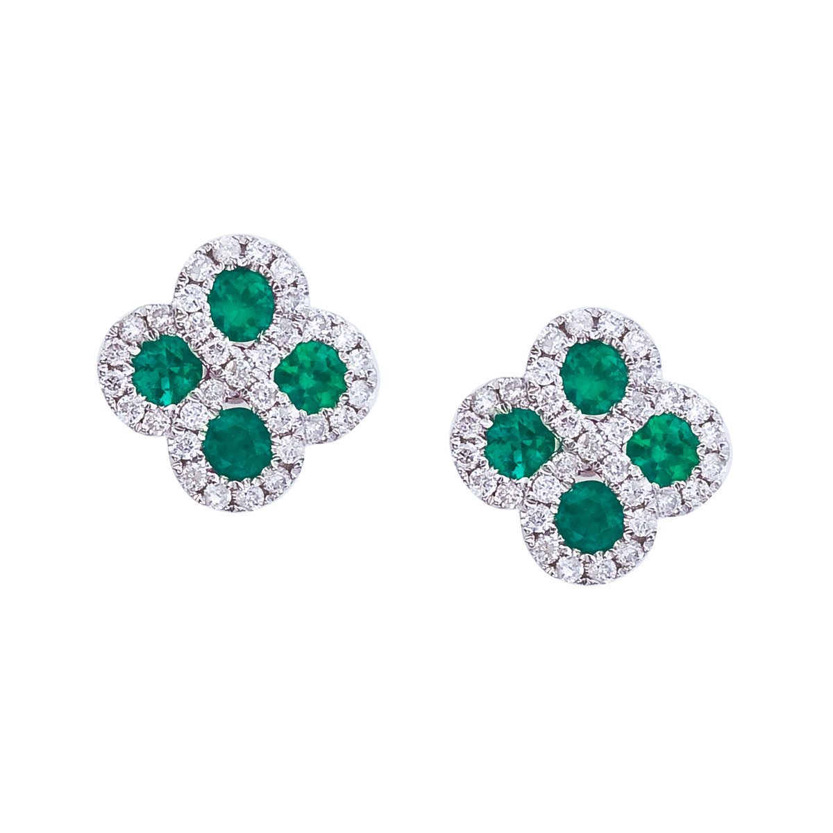 Beautiful clover shaped earrings with 2.7 mm emeralds surrounded by gleaming diamonds.