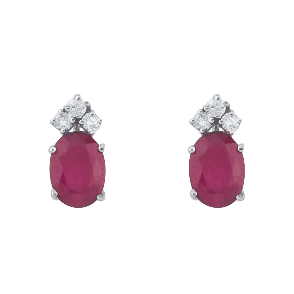 These 6x4 mm oval shaped ruby earrings are set in beautiful 14k white gold and feature .12 total carat diamonds.