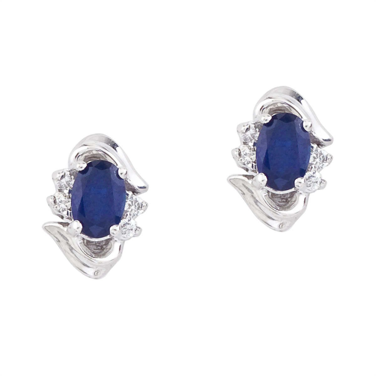 Stunning 14k white gold and sapphire earrings. Featuring natural 6x4 mm oval saphires and .11 tot...