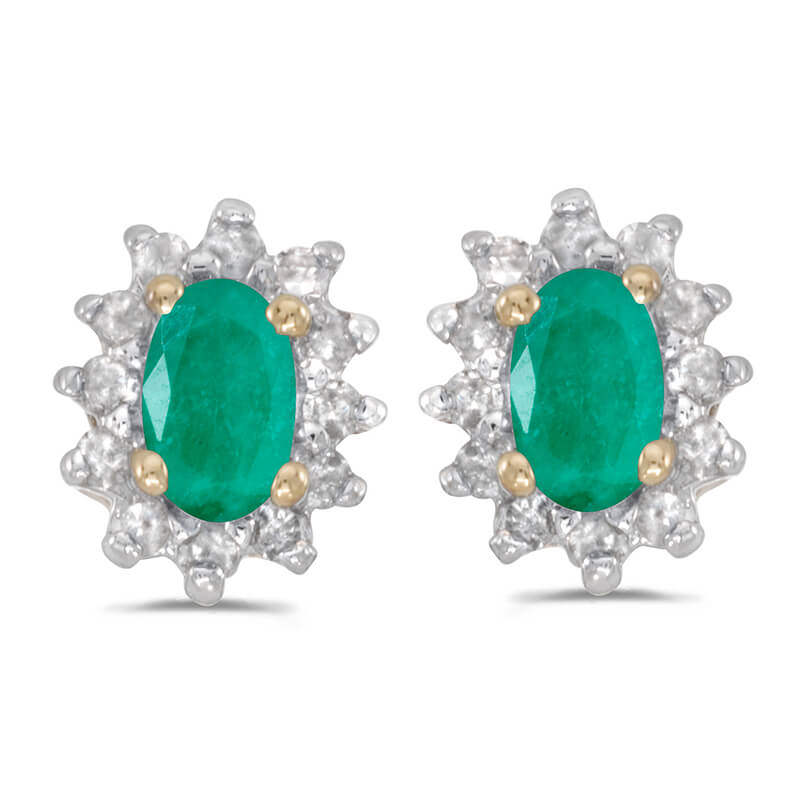 These 14k yellow gold oval emerald and .25 ct diamond earrings feature 5x3 mm genuine natural eme...