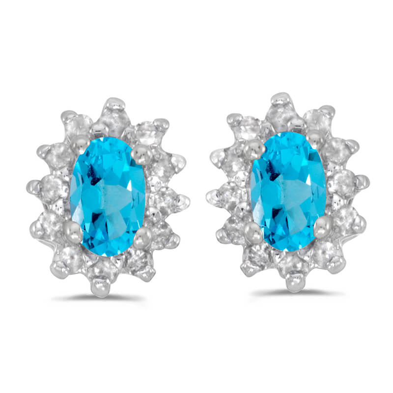 These 14k white gold oval blue topaz and .25 ct diamond earrings feature 5x3 mm genuine natural b...
