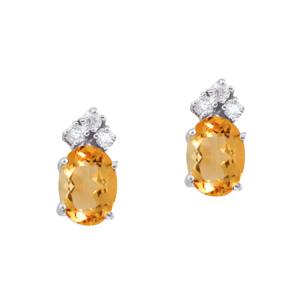 These 7x5 mm oval shaped citrine earrings are set in beautiful 14k white gold and feature .12 tot...