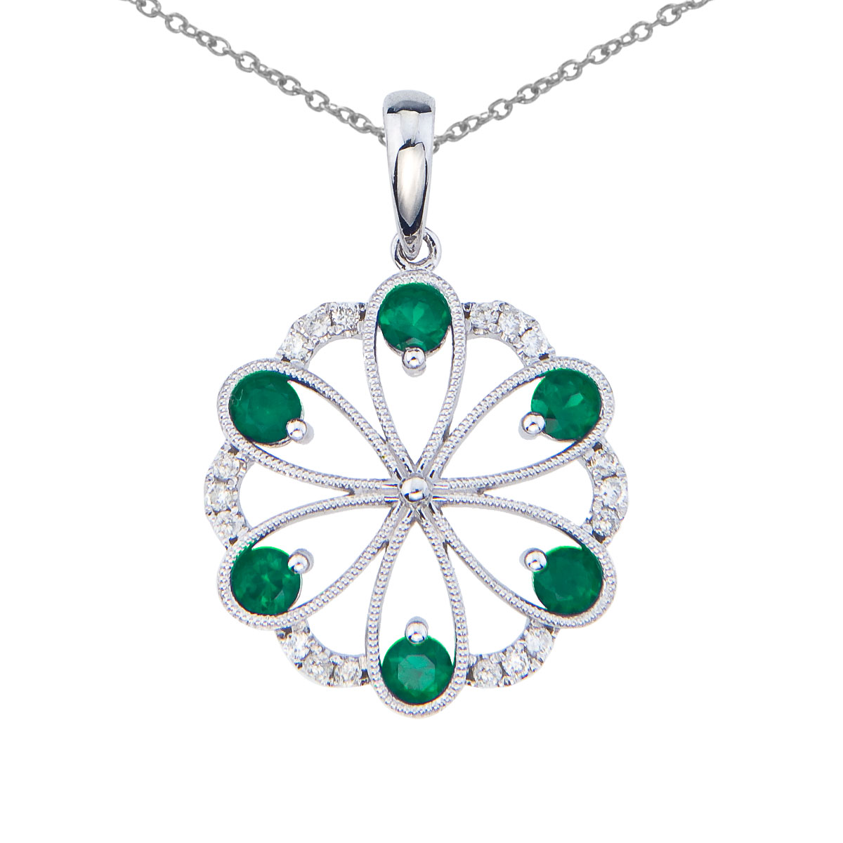 Beautiful floral pendant set in 14k white gold with 6 dazzling emeralds and .14 total carats of b...