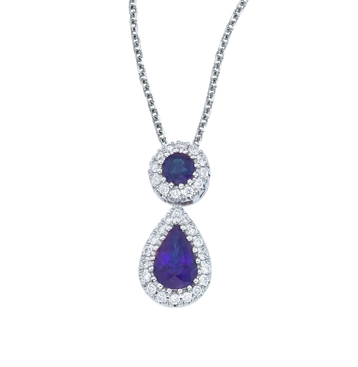This beautiful 14k white gold pendant features a 6x4 mm sapphire dangling from a 2.5 mm round sap...