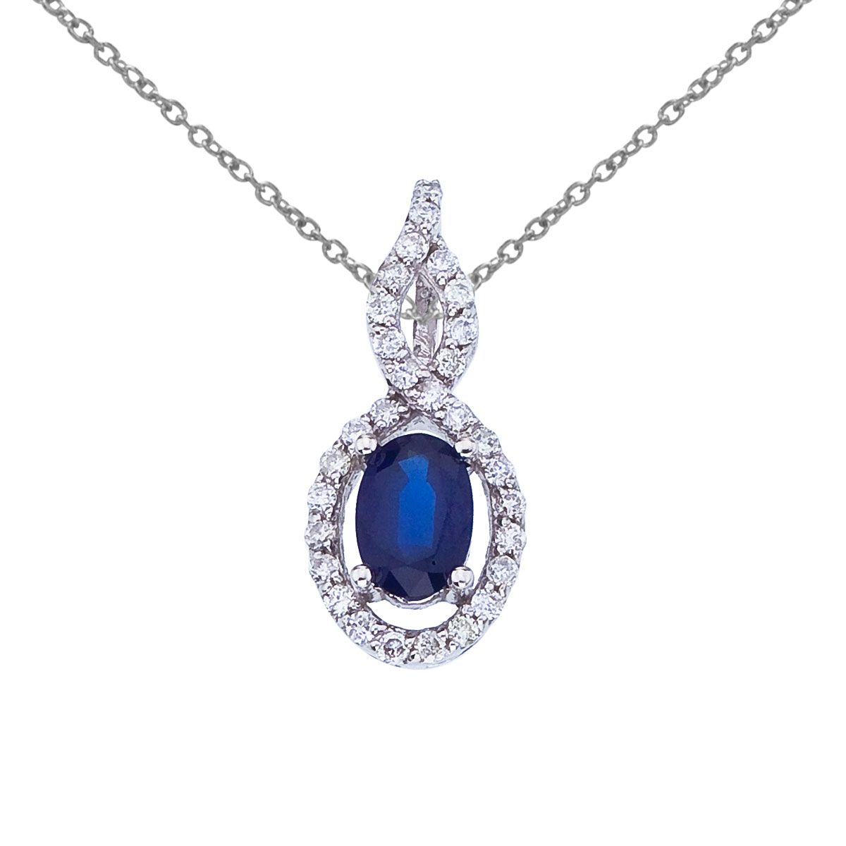 Luminous 6x4 mm sapphire pendant surrounded by .18 total ct diamonds set in 14k white gold.