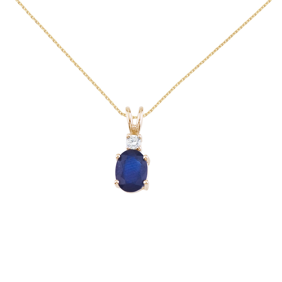 7x5 mm natural sapphire and diamond pendant set in 14k yellow gold.