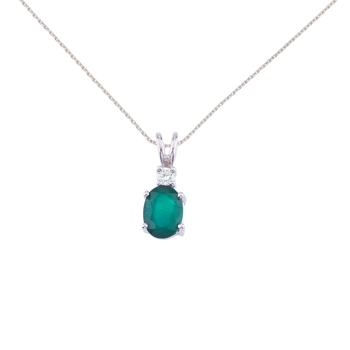 7x5 mm natural emerald and diamond pendant set in 14k white gold.