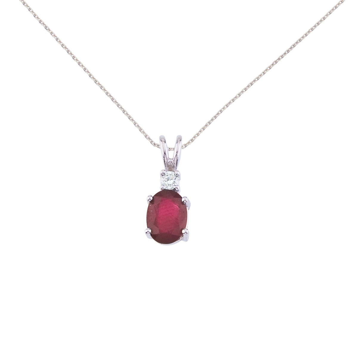 7x5 mm natural ruby and diamond pendant set in 14k white gold.