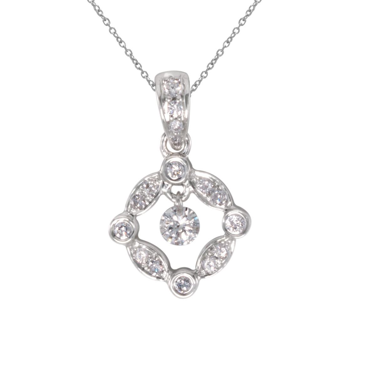 14k gold Dashinng Diamonds pendant with 0.25 total ct diamonds. The center dangling diamond dance...