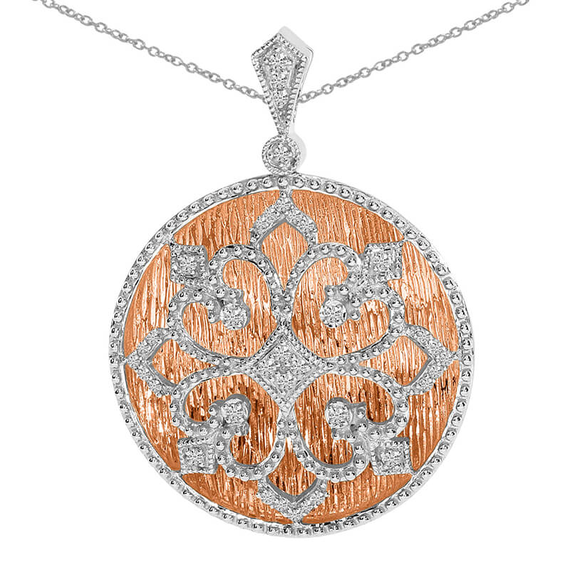 Antique style two-toned pendant with .20 total ct diamonds.