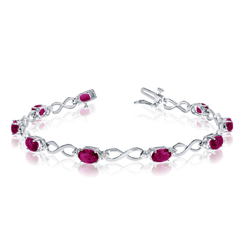 This 10k white gold oval ruby and diamond bracelet features nine 6x4 mm stunning natural ruby sto...
