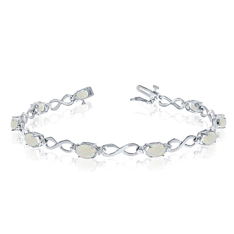 This 10k white gold oval opal and diamond bracelet features nine 6x4 mm stunning natural opal sto...