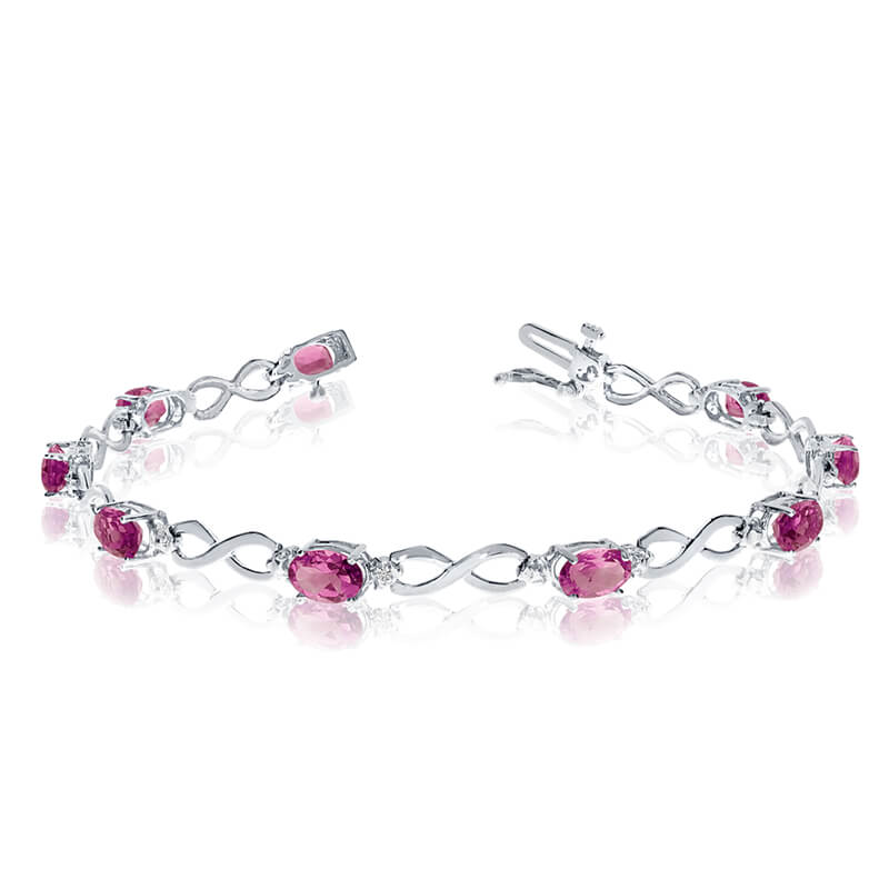 This 10k white gold oval pink topaz and diamond bracelet features nine 6x4 mm stunning natural pi...