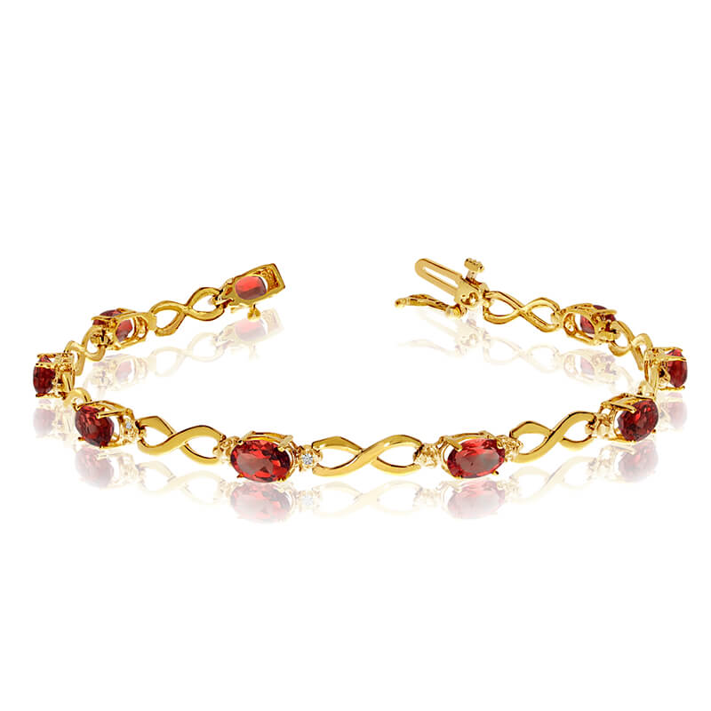 This 14k yellow gold oval garnet and diamond bracelet features nine 6x4 mm stunning natural garne...