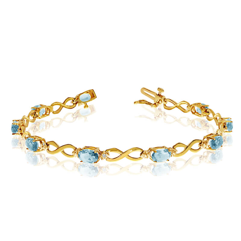 This 14k yellow gold oval aquamarine and diamond bracelet features nine 6x4 mm stunning natural a...