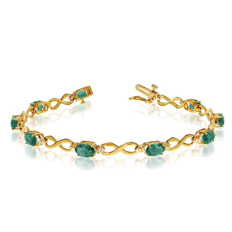 This 14k yellow gold oval emerald and diamond bracelet features nine 6x4 mm stunning natural emer...