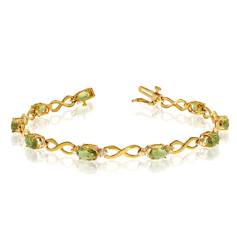 This 14k yellow gold oval peridot and diamond bracelet features nine 6x4 mm stunning natural peri...