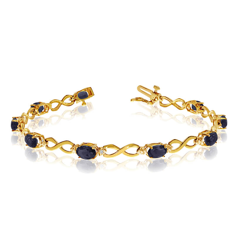 This 14k yellow gold oval sapphire and diamond bracelet features nine 6x4 mm stunning natural sap...