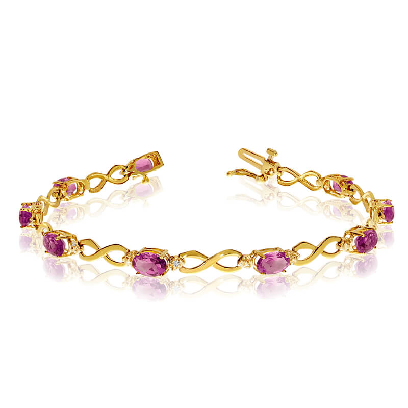 This 14k yellow gold oval pink topaz and diamond bracelet features nine 6x4 mm stunning natural p...