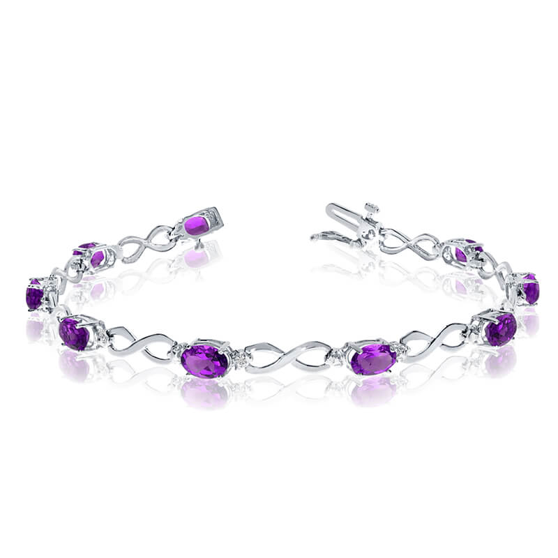 This 14k white gold oval amethyst and diamond bracelet features nine 6x4 mm stunning natural amet...