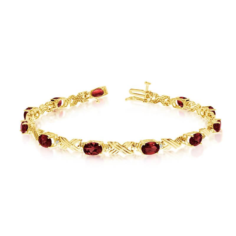 This 10k yellow gold oval garnet and diamond bracelet features eleven 6x4 mm stunning natural gar...