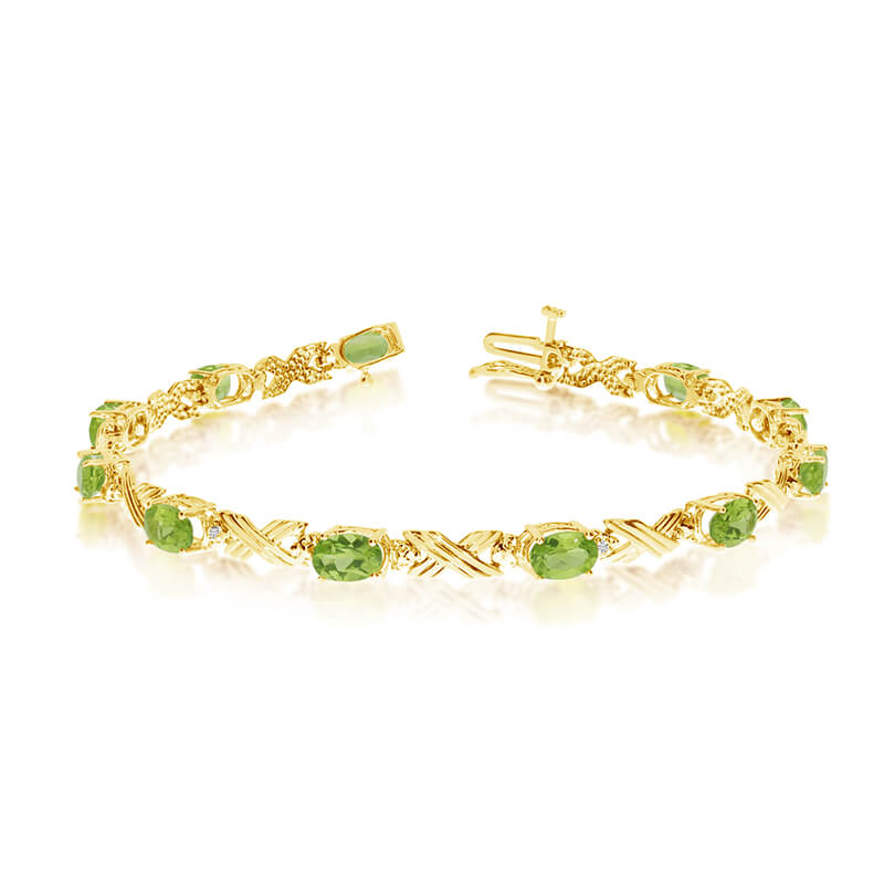 This 10k yellow gold oval peridot and diamond bracelet features eleven 6x4 mm stunning natural pe...