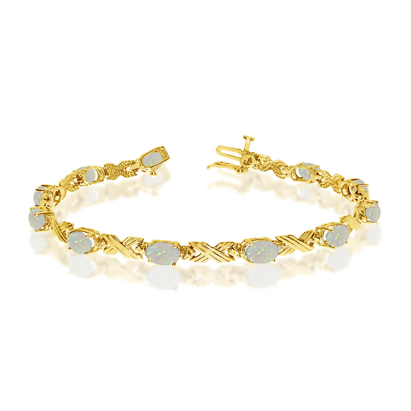 This 10k yellow gold oval opal and diamond bracelet features eleven 6x4 mm stunning natural opal ...