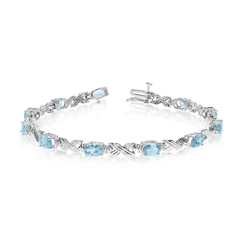This 10k white gold oval aquamarine and diamond bracelet features eleven 6x4 mm stunning natural ...