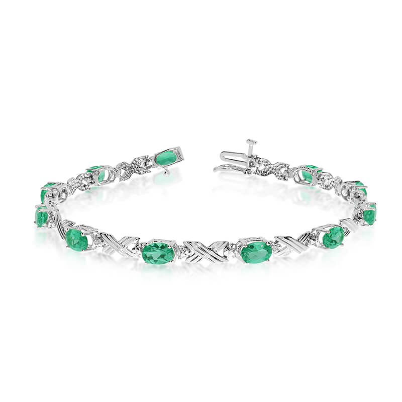 This 10k white gold oval emerald and diamond bracelet features eleven 6x4 mm stunning natural eme...