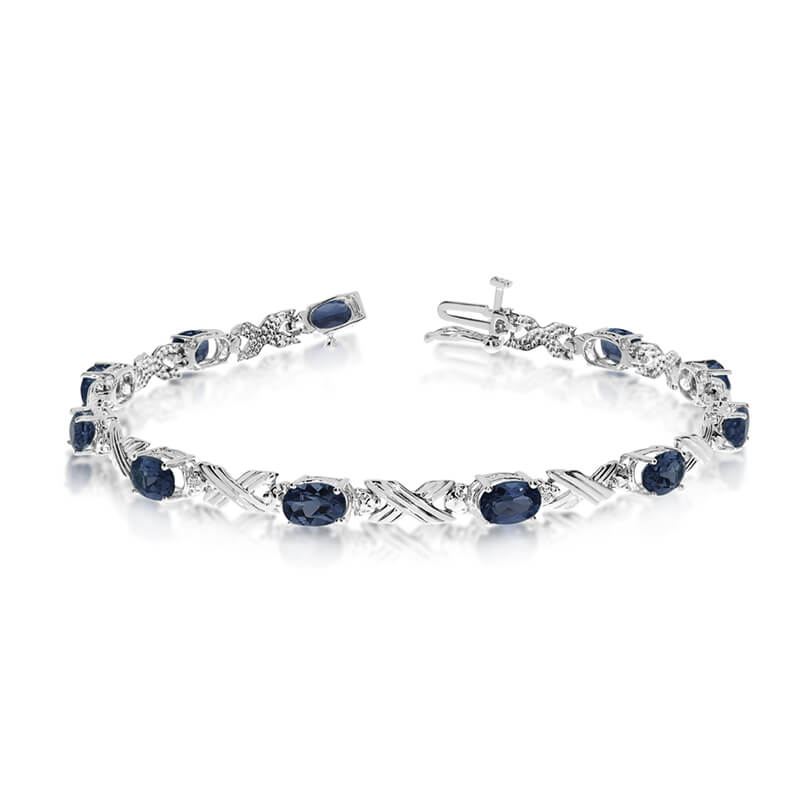 This 10k white gold oval sapphire and diamond bracelet features eleven 6x4 mm stunning natural sa...