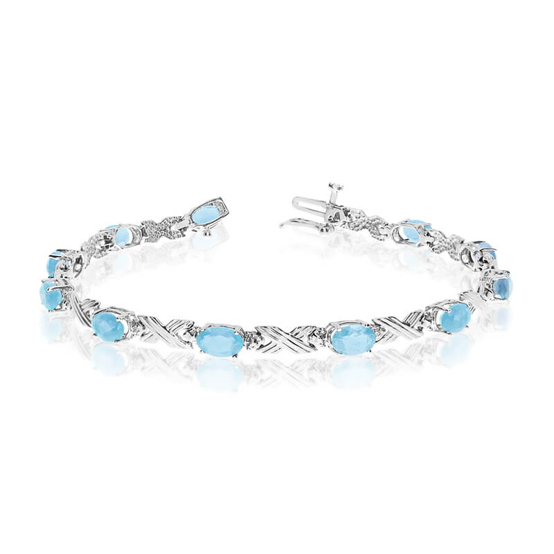 This 14k white gold oval aquamarine and diamond bracelet features eleven 6x4 mm stunning natural ...