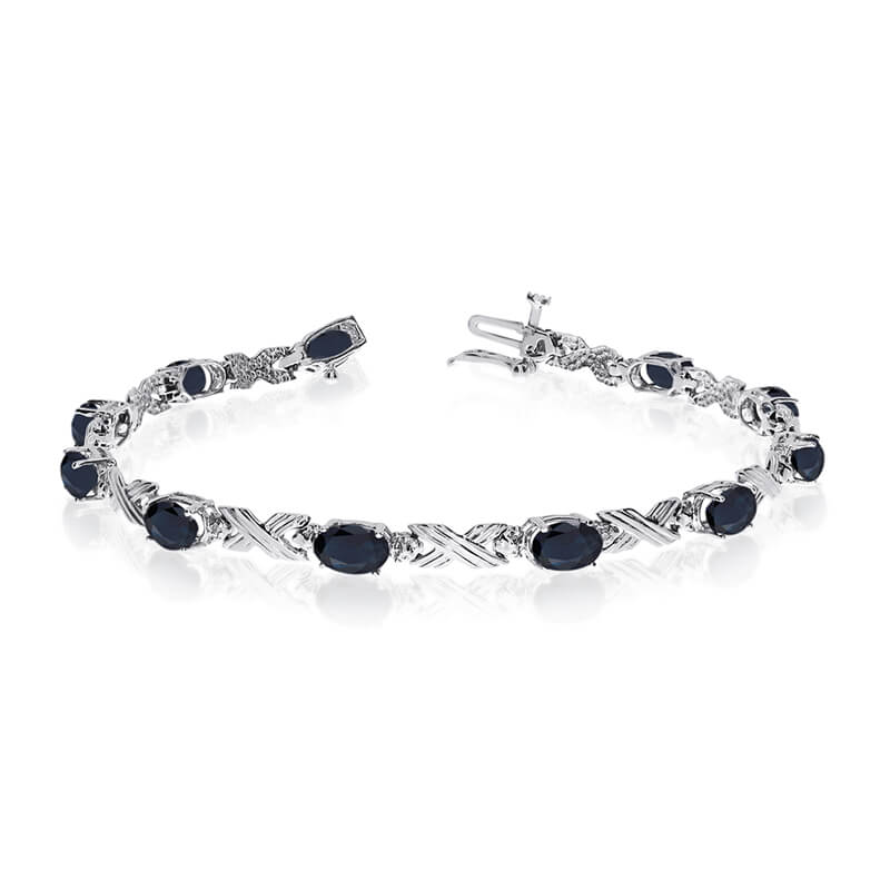 This 14k white gold oval sapphire and diamond bracelet features eleven 6x4 mm stunning natural sa...