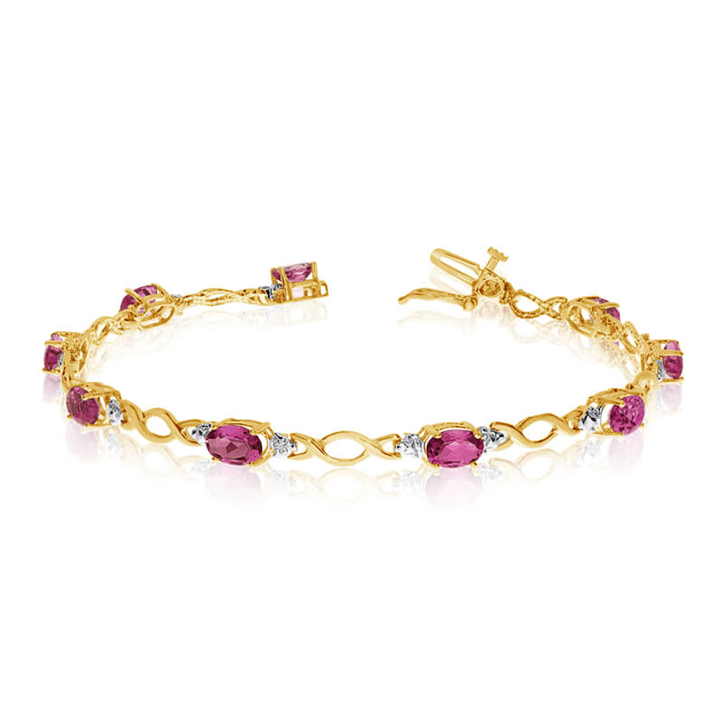 This 10k yellow gold oval ruby and diamond bracelet features ten 6x4 mm stunning natural ruby sto...