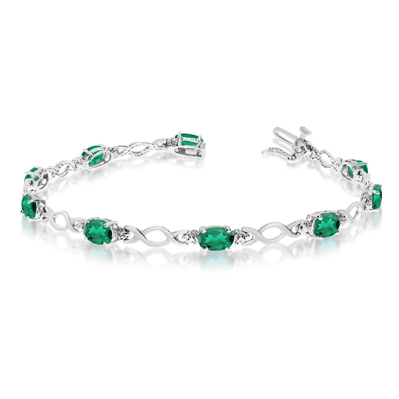 This 10k white gold oval emerald and diamond bracelet features ten 6x4 mm stunning natural emeral...