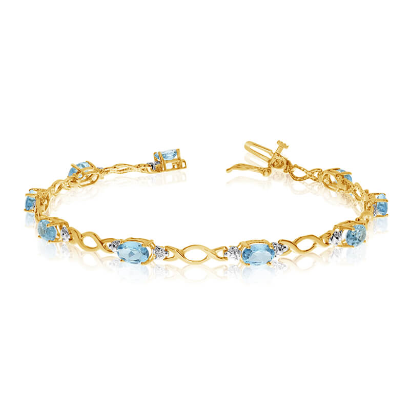 This 14k yellow gold oval aquamarine and diamond bracelet features ten 6x4 mm stunning natural aq...